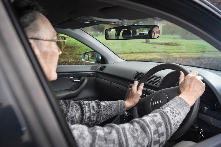 Older driver in car